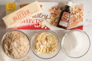 ingredients for almond tart.  puff pastry, ground almond, almond slices, sugar, butter and almond extract