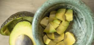 avocado cubed in mortar and pestle