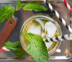 Mint Julep with mint leaf ice and straws