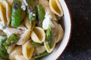 sugar snap pea and goat cheese pasta in a bowl