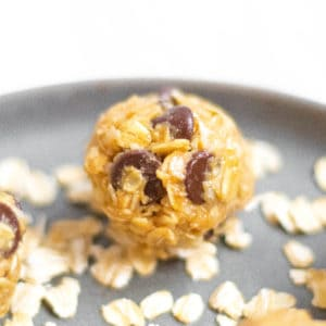 oatmeal energy bite with chocolate chips on a plate with rolled oats