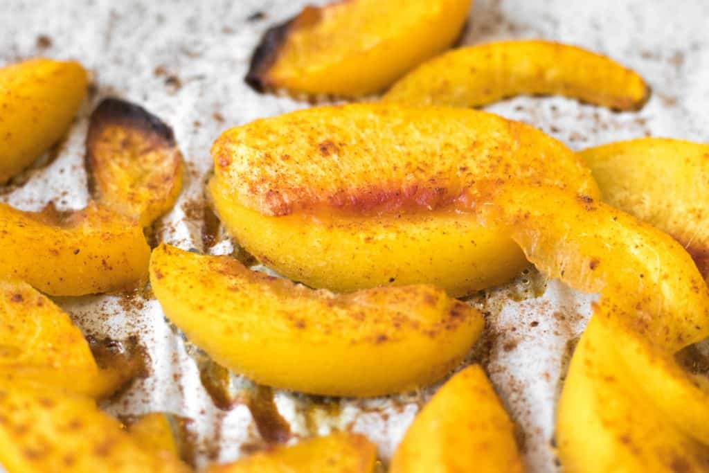 roasted peaches on a sheet pan