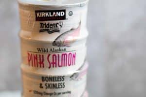 a stack of Kirkland brand canned salmon