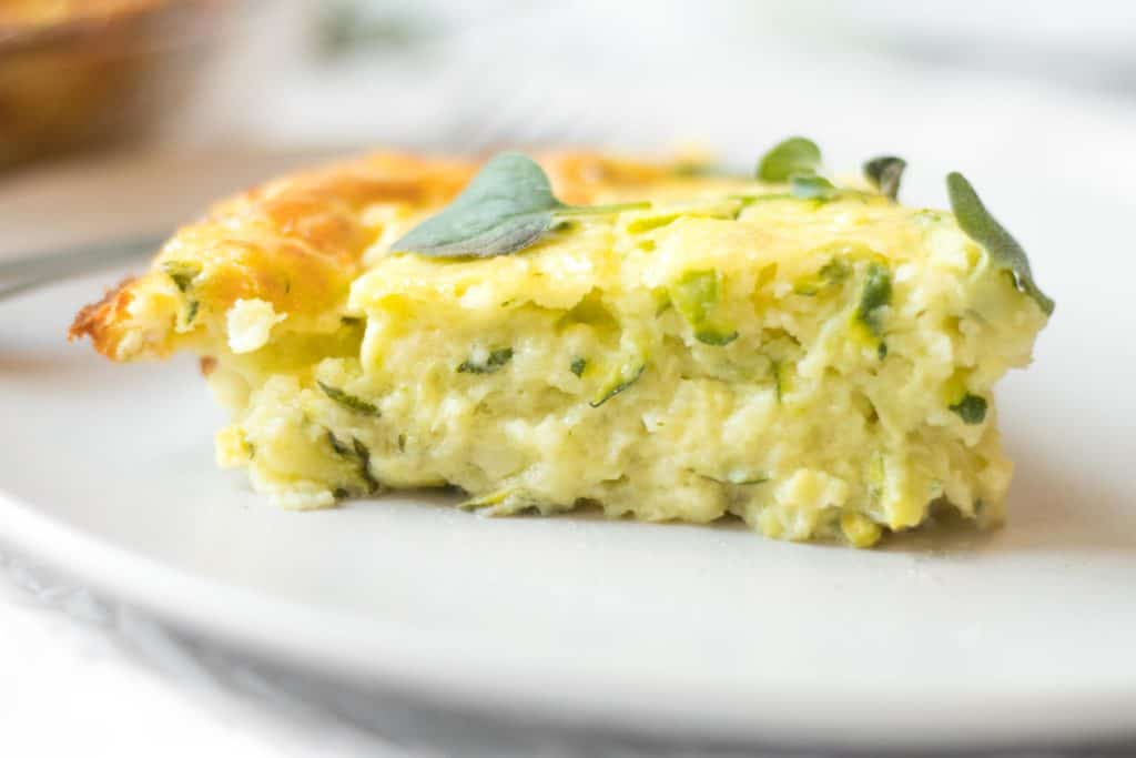 slice of zucchini quiche on a plate