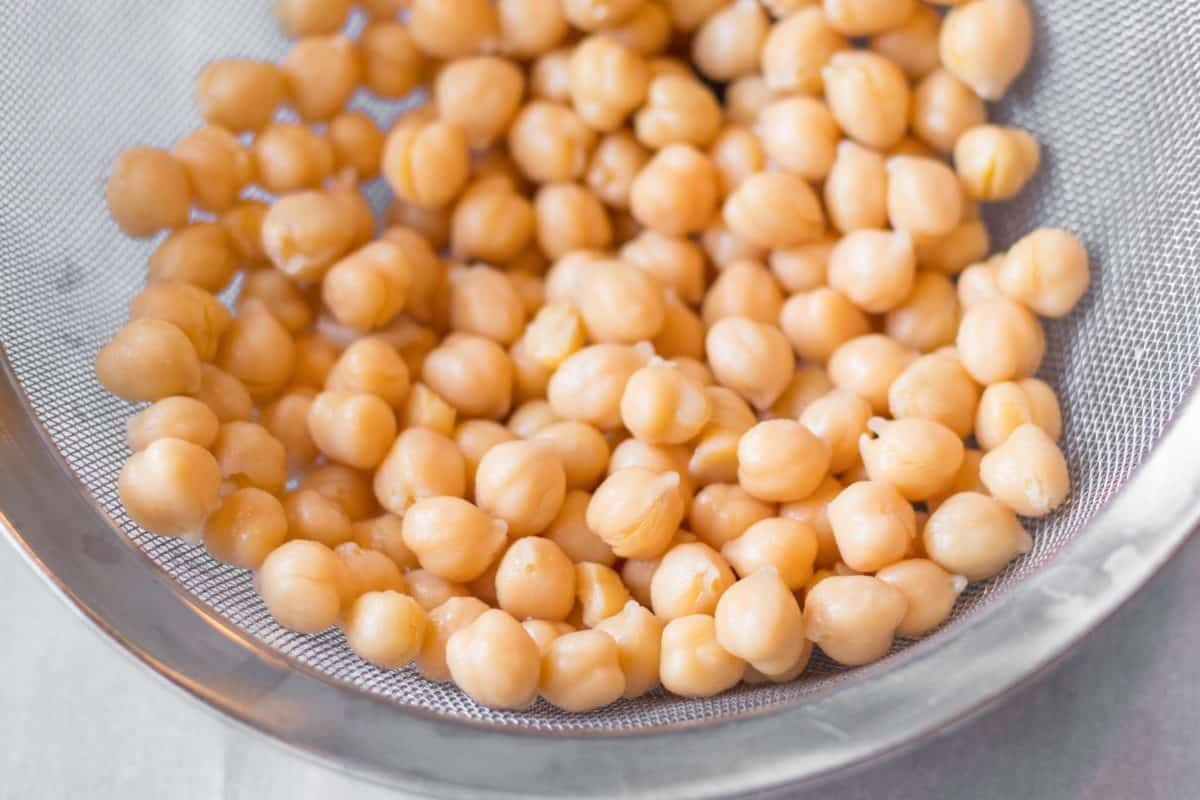 chickpeas in a metal mesh strainer