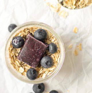 overnight oats with blueberry puree and whole blueberries on top