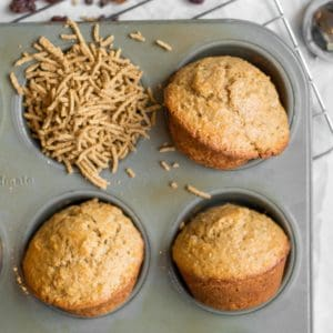 four all bran muffins in a muffin tin
