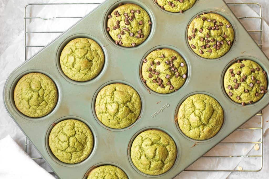 green blender muffins in a muffin tin