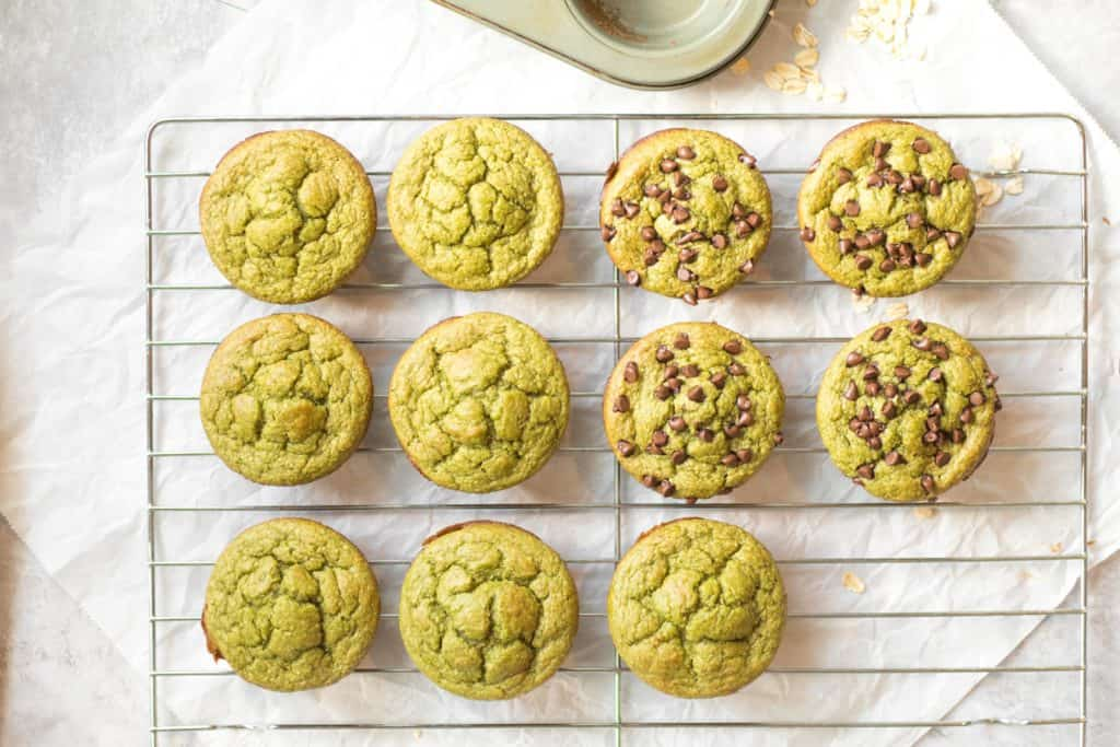 green blender muffins on a cooling rack some with chocolate chips