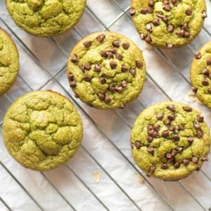 green blender muffins on parchment paper some with chocolate chips