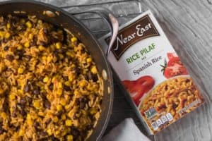 mexican rice skillet next to box of near east spanish rice box