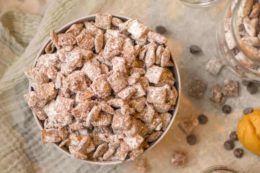 big bowl of puppy chow with chocolate chips scattered around