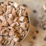 puppy chow in a big bowl with a scoop of peanut butter