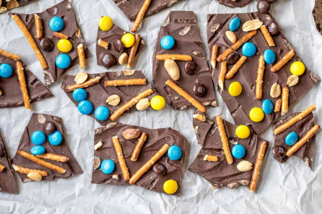 sweet and salty chocolate bark pieces on parchment paper