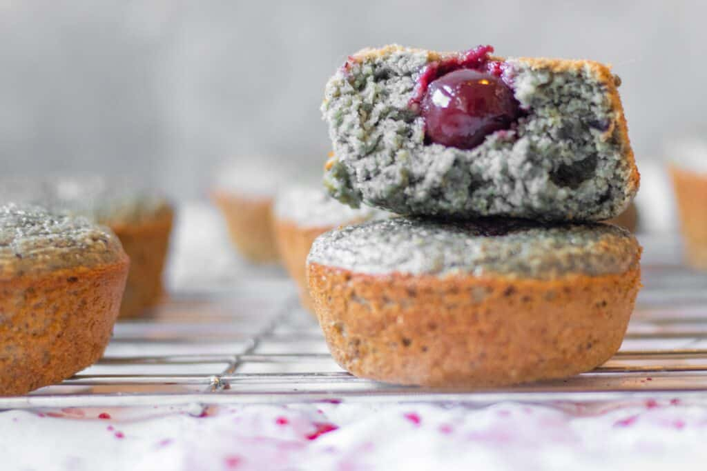 stacked cherry blender muffins with a cherry hidden in the middle