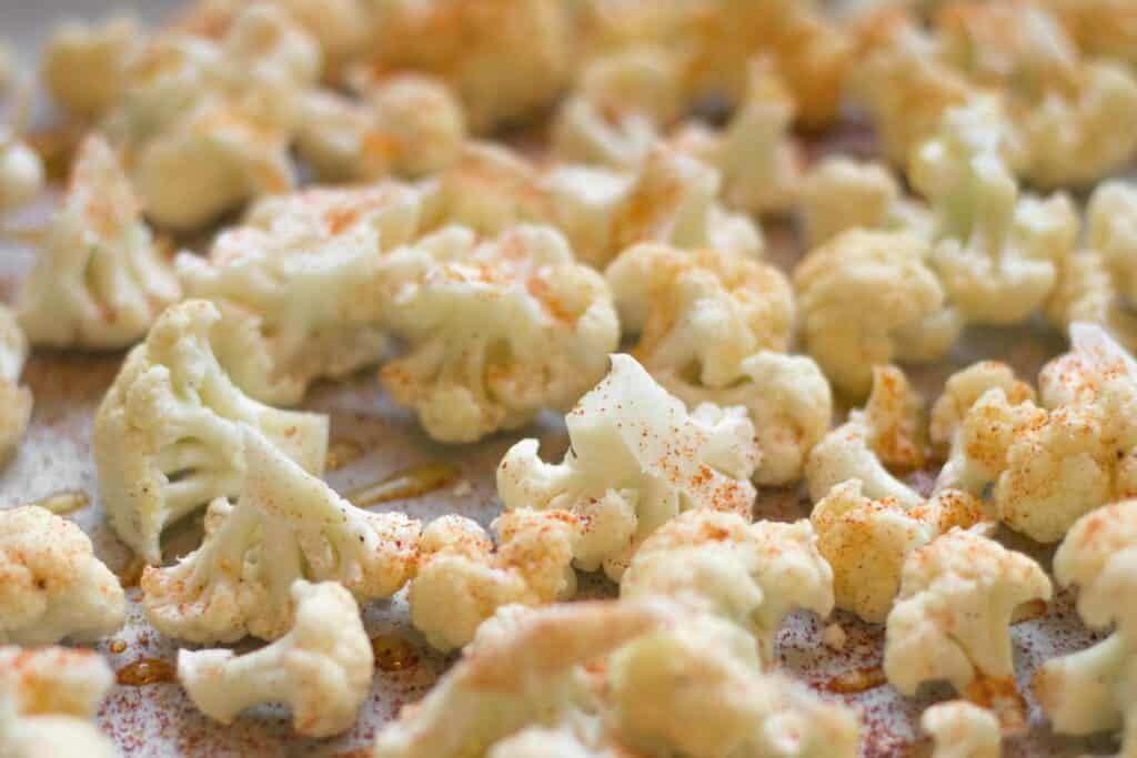 raw cauliflower with spices on top