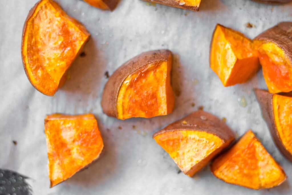 chunks of roasted sweet potato on a baking sheet