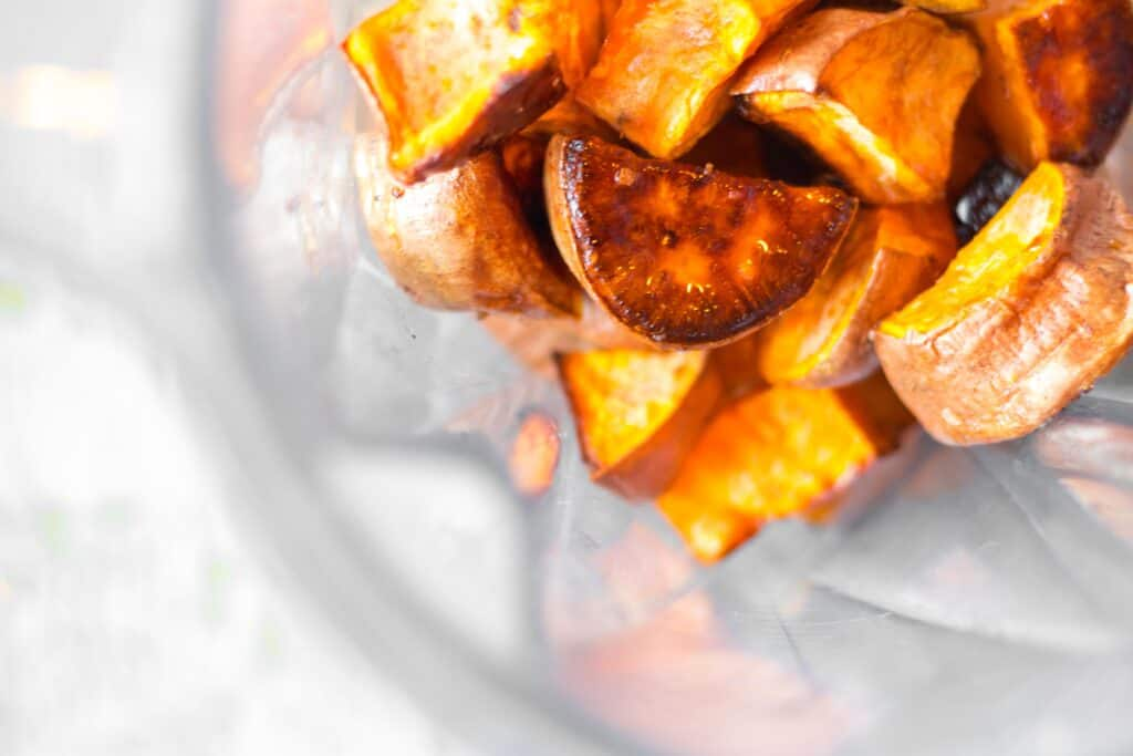 roasted sweet potato chunks in a vitamix blender container