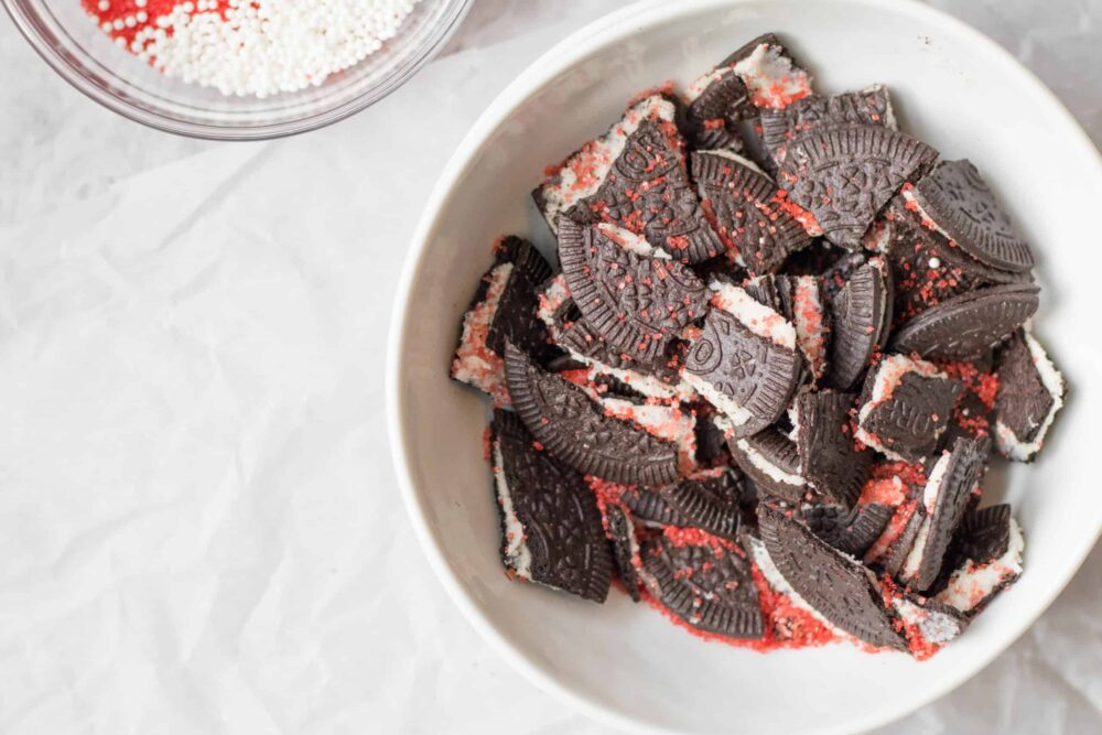 oreos with red sprinkles in a bowl