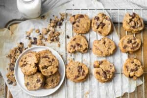 chocolate coffee chunk cookies on a cooling rack and small plate