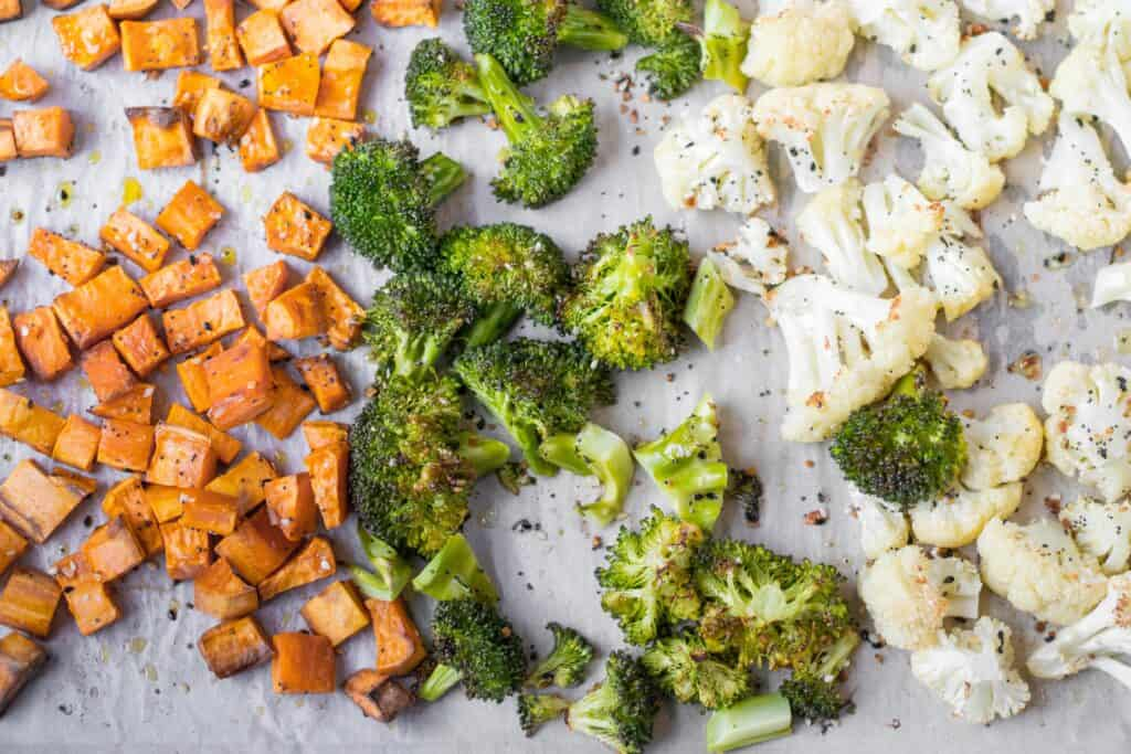 roasted veggies on a baking sheet with everything seasoning