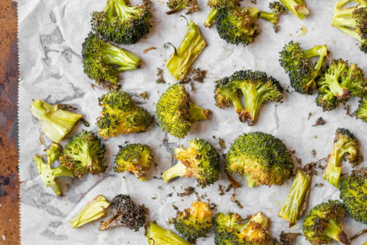 roasted broccoli on parchment paper lined sheet pan