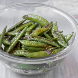 sugar snap peas in a glass bowl