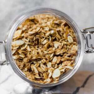 vanilla almond granola in a glass jar from overhead