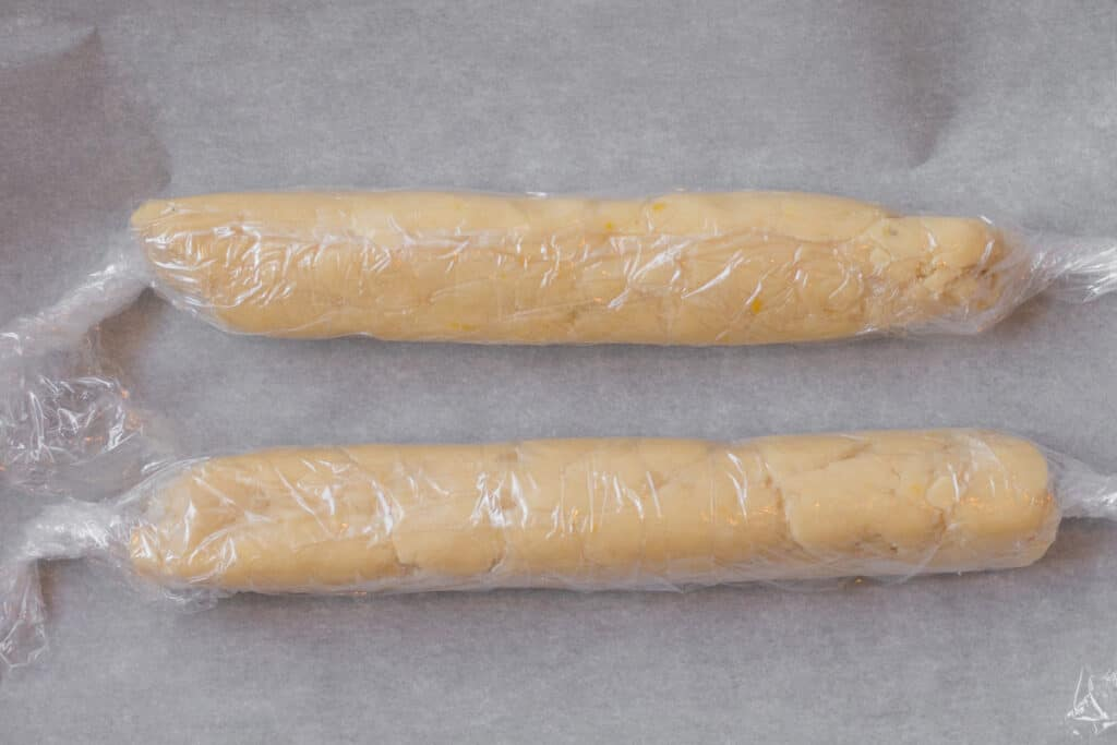 two logs of cookie dough wrapped in plastic wrap