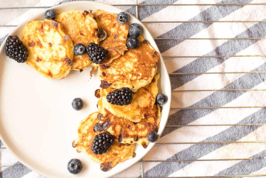 cottage cheese pancakes with blackberries on a plate