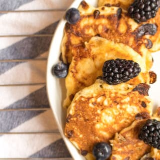 cottage cheese pancakes on a plate with blackberries