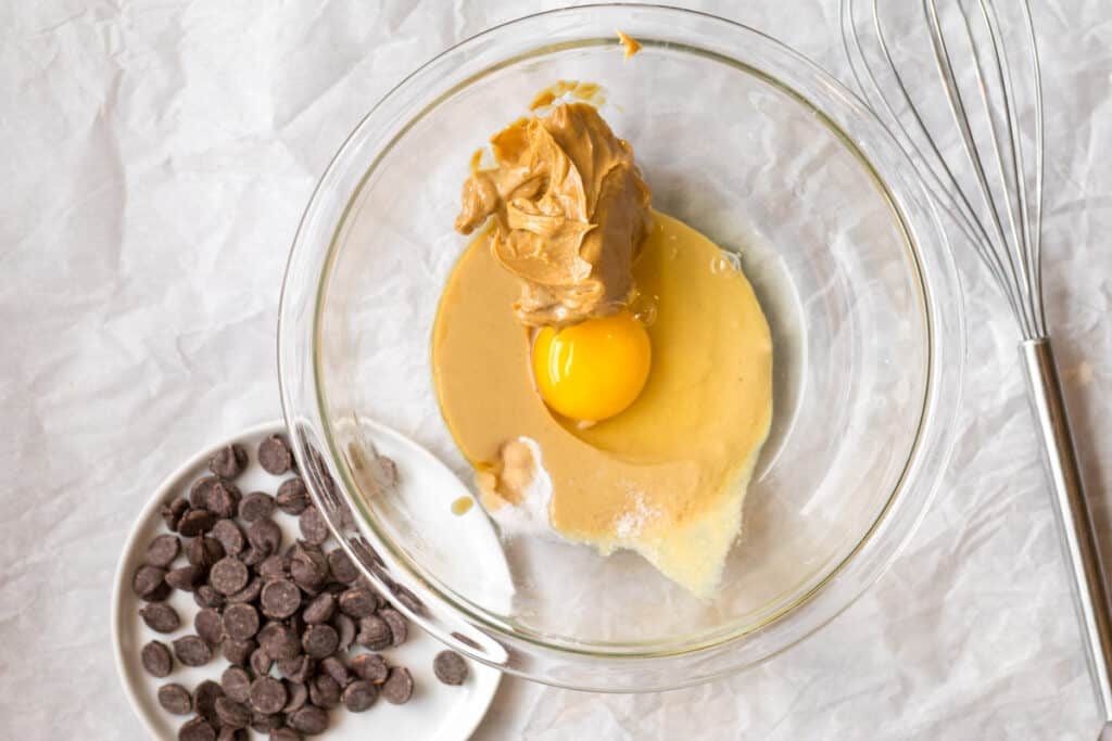 egg, peanut butter, tahini, maple syrup and baking soda in a glass bowl