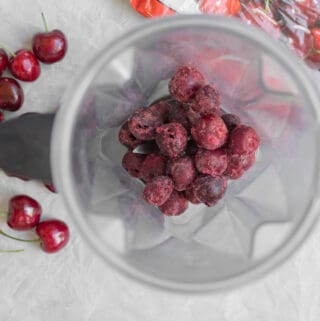 frozen cherries in a vitamix blender container