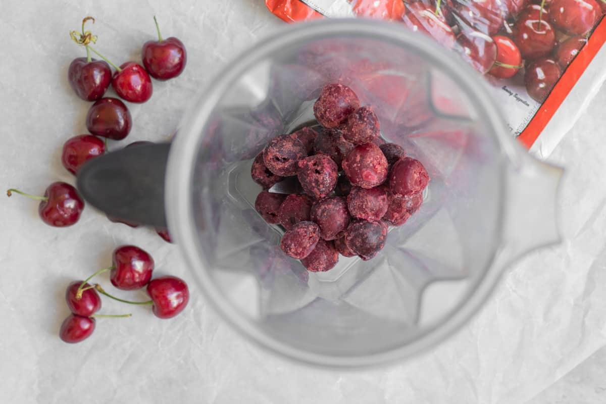 frozen cherries in a vitamix blender container