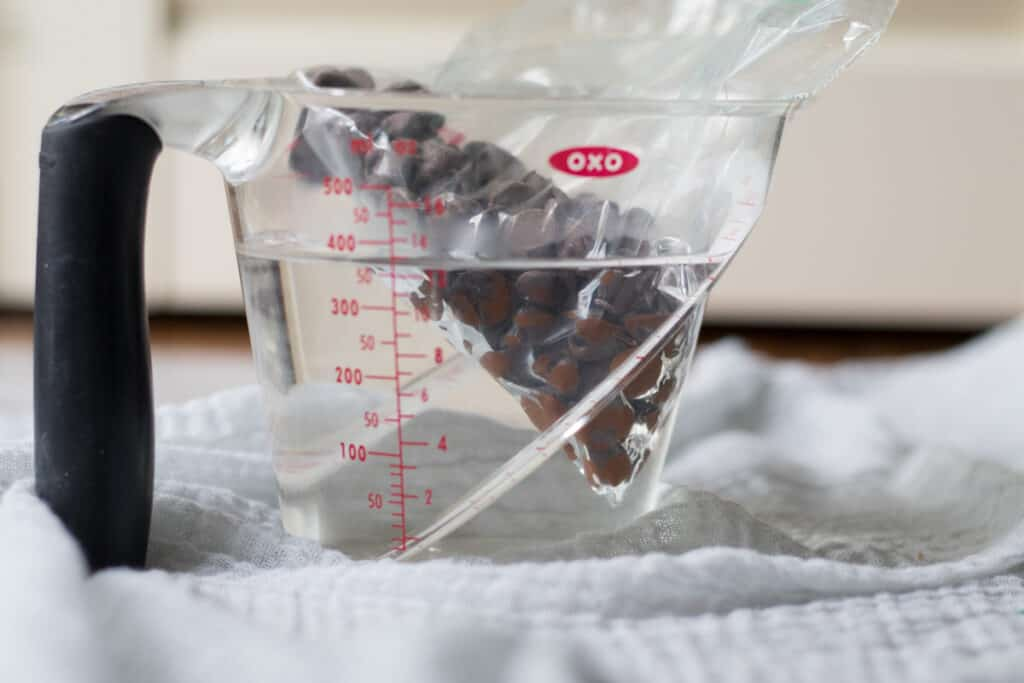 chocolate chips in zip top bag in hot water