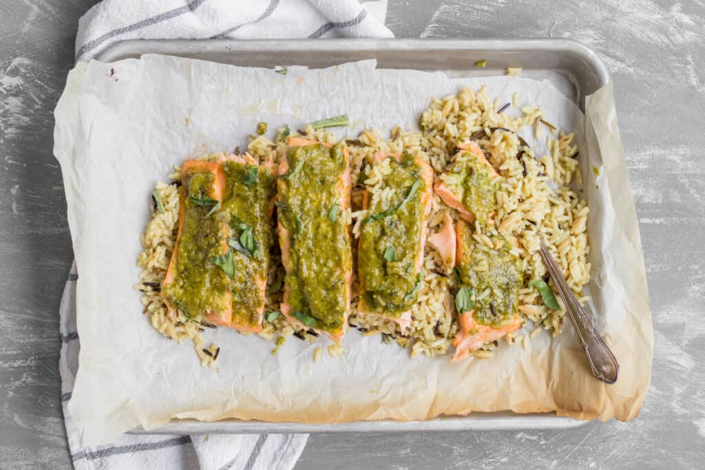 pesto salmon on a bed of rice