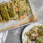 pesto salmon on baking sheet and serving plate