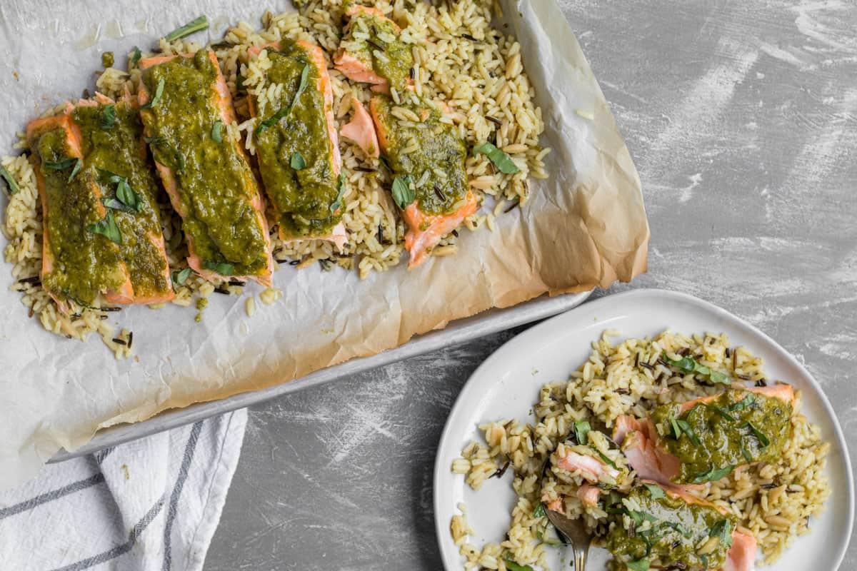 pesto salmon on baking sheet and serving plate