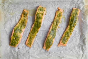 salmon with pesto spread on it