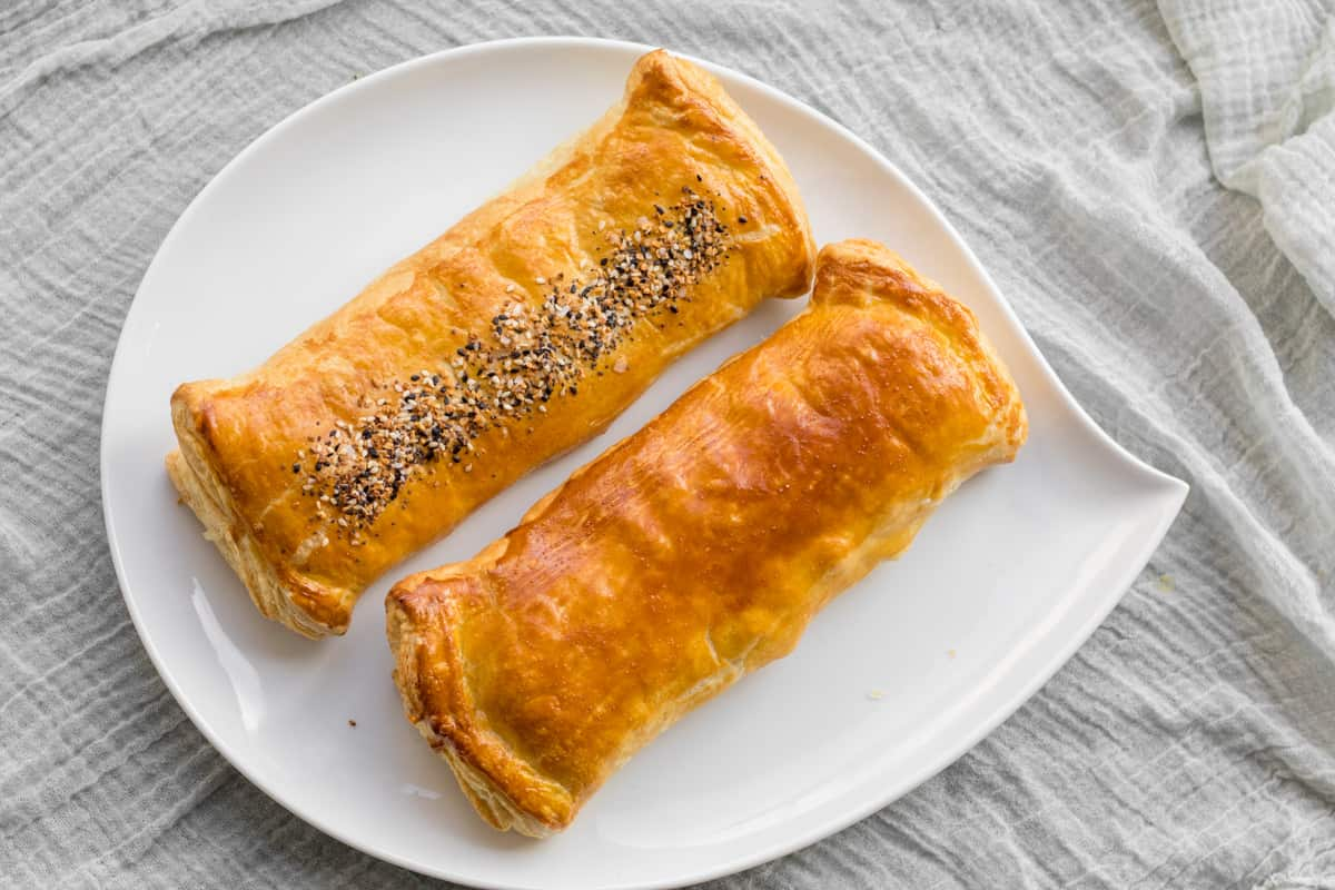 two puff pastry potato bourekas on a serving dish