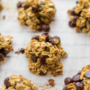breakfast banana cookie with chocolate chips on parchment paper