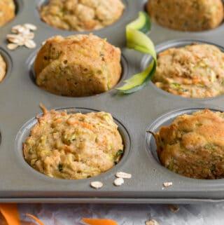 carrot zucchini muffins in a muffin tin
