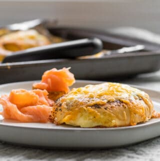 egg in a hole bagel with lox and sheet pan in back