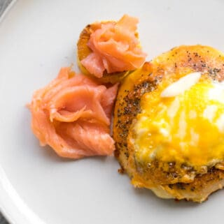 bagel with egg and cheese on a plate with lox
