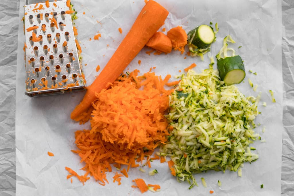 grated carrots and zucchini with a box grater