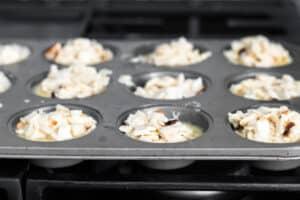 farfel muffin batter in a muffin tin