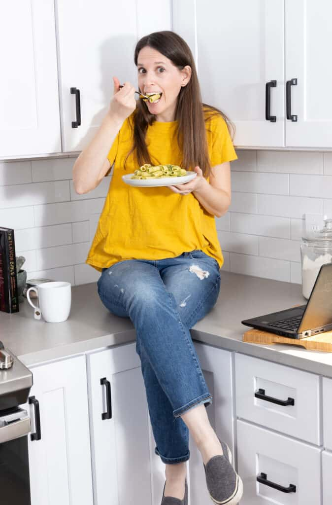 marni in yellow shirt eating pasta