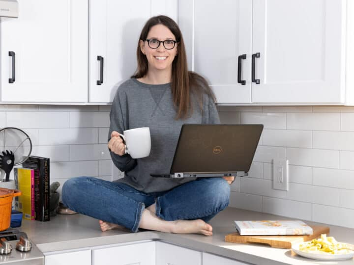 marni sitting on the counter with coffee and computer