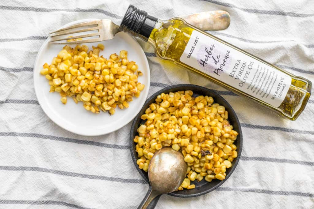 charred corn with olive oil and utensils