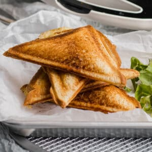 cooked grilled cheese toasties on a platter